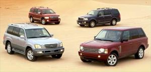 2004 Lexus LX 470, 2004 Lincoln Navigator Ultimate 4x4, 2004 Land Rover Range Rover HSE, 2004 Infiniti QX56 AWD - Fullsize Luxury SUV Comparison - Truck Trend