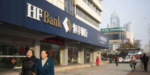 Fancy Meals and Loans for Friends: China's Banks Face Costly Cleanup
