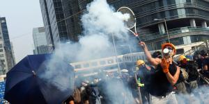 Violence Erupts as Hong Kong Protesters and Riot Police Resume Hostilities